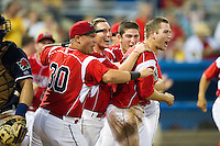 Batavia Muckdogs shortstop Anthony Melchionda #16 (front), Jordan Walton #31 (center) and David Bergin #30 celebrate after Melchionda scored the game winning run in the bottom of the 9th inning on a base hit by Jacob Wilson #32 (not pictured) during a NY-Penn League game at Dwyer Stadium on July 4, 2012 in Batavia, New York.  Batavia defeated Connecticut 3-2.  (Mike Janes/Four Seam Images)