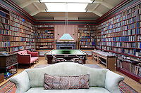Inside the house on the Clandeboye estate, which is the home to Lady Dufferin, Marchioness of Dufferin and Ava. The billiards room is lined with bookshelves.