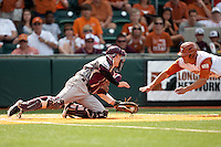 Texas designated hitter Jonathan Walsh #33 slides head-first towards Texas A&M catcher Cole Lankford #12 to score the winning run in the bottom of the ninth inning ending the NCAA baseball game on April 29, 2012 at UFCU Disch-Falk Field in Austin, Texas. The Longhorns rallied for 2 runs in the last inning beat the Aggies 2-1 in the final regular season game scheduled for the long time rivals. (Andrew Woolley / Four Seam Images)
