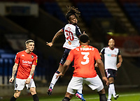 Bolton Wanderers' Peter Kioso (centre) flicks the ball on <br /> <br /> Photographer Andrew Kearns/CameraSport<br /> <br /> The EFL Sky Bet League Two - Bolton Wanderers v Salford City - Friday 13th November 2020 - University of Bolton Stadium - Bolton<br /> <br /> World Copyright © 2020 CameraSport. All rights reserved. 43 Linden Ave. Countesthorpe. Leicester. England. LE8 5PG - Tel: +44 (0) 116 277 4147 - admin@camerasport.com - www.camerasport.com