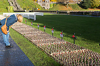 Pictured: A woman looks at the thousands of crosses at the field of remembrance at Cardiff Castle, Wales, UK. Thursday 10 November 2016 <br /> Re: A field of remembrance honouring members of the armed forces since World War One has opened at Cardiff Castle.<br /> More than 10,000 remembrance crosses and tributes from other faiths have been planted at the Welsh national field of remembrance, which will be open until 19 November.<br /> This year also commemorates the centenary of Mametz Wood at the Battle of the Somme.