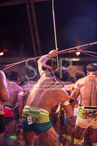 Kamayura warriors perform a war dance; one draws the string on his bow with an arrow notched at the first ever International Indigenous Games, in the city of Palmas, Tocantins State, Brazil. The games will start officially with an opening ceremony on Friday the 23rd October. Photo © Sue Cunningham, pictures@scphotographic.com 21st October 2015