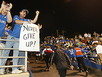 "24 July 2004: Earthquakes' fans put up a sign says ""Never Give up!"" to the team after Earthquakes scored two goals at 91 and 94 minutes of the game against New England Revolution at Spartan Stadium in San Jose, California.   Earthquakes tied Revolution, 2-2.   Credit: Michael Pimentel / ISI"