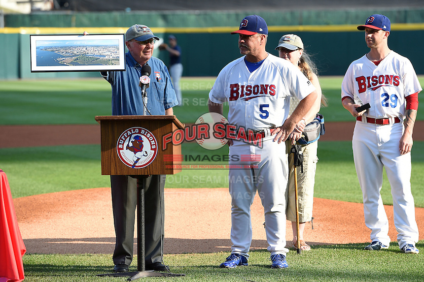 Buffalo Bisons manager Gary Allenson (5) is presented with a city landscape photo before a game against the Pawtucket Red Sox on August 26, 2014 at Coca-Cola Field in Buffalo, New  York.  Pawtucket defeated Buffalo 9-3.  (Mike Janes/Four Seam Images)