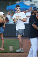 Justin Jarvis, a pitcher in the Milwaukee Brewers minor league system, ends up with whipped cream on his face during a between innings contest during the Southern Collegiate Baseball League game between the Carolina Venom and the Mooresville Spinners at Moor Park on June 22, 2020 in Mooresville, NC.  The Spinners defeated the Venom 7-2. (Brian Westerholt/Four Seam Images)
