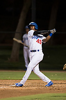 AZL Dodgers left fielder Kevin Aponte (49) follows through on his swing during an Arizona League game against the AZL White Sox at Camelback Ranch on July 3, 2018 in Glendale, Arizona. The AZL Dodgers defeated the AZL White Sox by a score of 10-5. (Zachary Lucy/Four Seam Images)