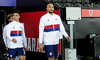 SWANSEA, WALES - NOVEMBER 12: Antonee Robinson #5 and John Brooks #6 of the United States walking out during a game between Wales and USMNT at Liberty Stadium on November 12, 2020 in Swansea, Wales.