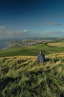 A walker on the summit of Byne Hill looking across Girvan and the Ayrshire Coast, Girvan, Ayrshire<br /> <br /> Copyright www.scottishhorizons.co.uk/Keith Fergus 2011 All Rights Reserved