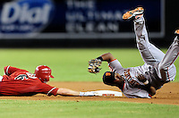 Sept. 8, 2010; Phoenix, AZ, USA; Arizona Diamondbacks base runner Stephen Drew (left) is safe at second base with an RBI double as San Francisco Giants infielder Edgar Renteria is upended in the seventh inning at Chase Field. Mandatory Credit: Mark J. Rebilas-