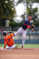 GCL Red Sox second baseman Santiago Espinal (43) throws to first as Tristan Graham (24) slides in during a game against the GCL Orioles on August 16, 2016 at the Ed Smith Stadium in Sarasota, Florida.  GCL Red Sox defeated GCL Orioles 2-0.  (Mike Janes/Four Seam Images)