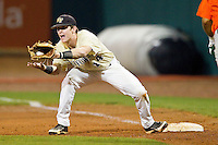 Conor Keniry #14 of the Wake Forest Demon Deacons fields a throw at first base during Game Nine of the 2012 ACC Baseball Championship against the Miami Hurricanes at NewBridge Bank Park on May 25, 2012 in Winston-Salem, North Carolina.  The Hurricanes defeated the Demon Deacons 6-3.  (Brian Westerholt/Four Seam Images)