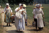 "AJ2778, Valley Forge Park, reenactment, Valley Forge, Pennsylvania, Women dressed in traditional colonial costumes walk together at the reenactment of the American Revolution at the """"March out of the Continental Army"""" in Valley Forge National Historical Park in Valley Forge in the state of Pennsylvania."