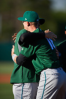 Daytona Tortugas designated hitter Blake Butler (16) hugs manager Eli Marrero (1) during introductions before a game against the Florida Fire Frogs on April 6, 2017 at Osceola County Stadium in Kissimmee, Florida.  Daytona defeated Florida 3-1.  (Mike Janes/Four Seam Images)
