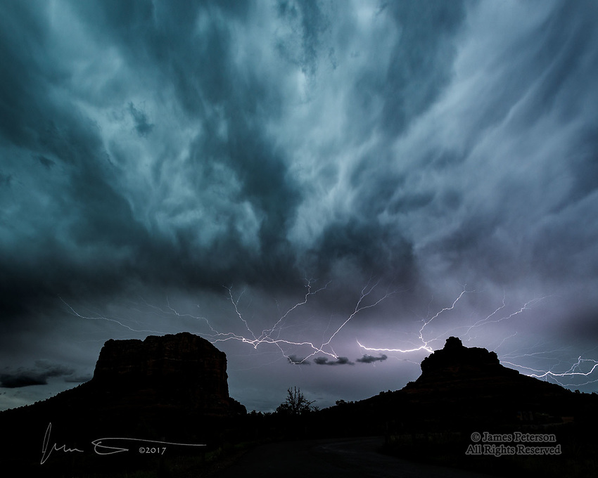 Lightning over Courthouse Vista, Sedona, Arizona ©2017 James D Peterson.  One of our monsoon thunderstorms, moving through the area at twilight, creates a dramatic moment above Bell Rock and Courthouse Butte.