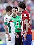 Atletico de Madrid's Stefan Savic (r) and Granada Club de Futbol's David Barral have words with the referee Eduardo Prieto Iglesias during La Liga match. April 17,2016. (ALTERPHOTOS/Acero)