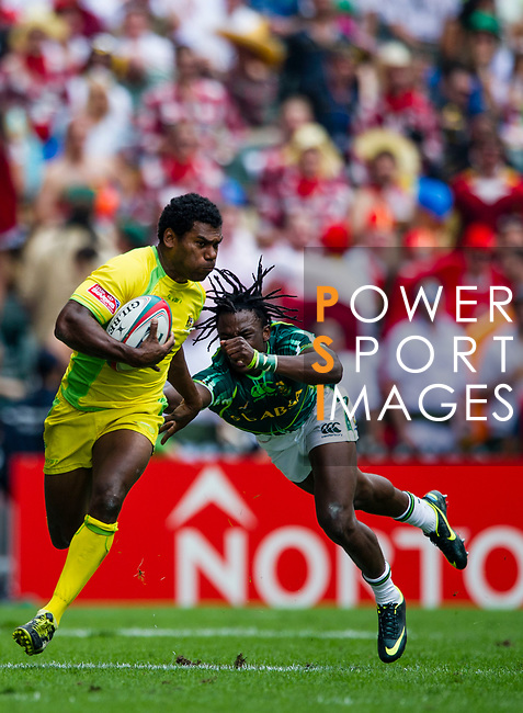 South Africa play Australia on Day 2 of the Cathay Pacific / HSBC Hong Kong Sevens 2013 on 23 March 2013 at Hong Kong Stadium, Hong Kong. Photo by Manuel Queimadelos / The Power of Sport Images