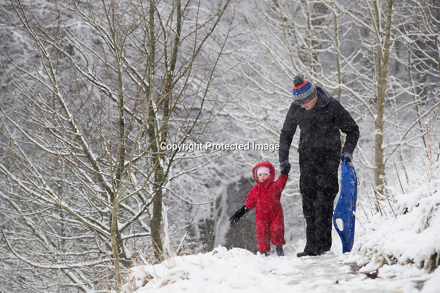 25/11/17<br /> <br /> Richard Scott with daughter Anna, 2.<br /> <br /> <br /> Snow continues to fall on Mam Tor near Castleton in the Derbyshire Peak District.<br />  <br /> All Rights Reserved F Stop Press Ltd. +44 (0)1335 344240 +44 (0)7765 242650  www.fstoppress.com