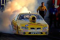 Apr 7, 2006; Las Vegas, NV, USA; NHRA Pro Stock driver Warren Johnson does a burnout in the GM Performance Parts Pontiac GTO during qualifying for the Summitracing.com Nationals at Las Vegas Motor Speedway in Las Vegas, NV. Mandatory Credit: Mark J. Rebilas