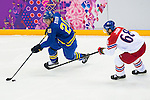 (L) Henrik Zetterberg of Sweden competes for the ice (R) Jaromir Jagr of Czech Republic during the match between Sweden vs Czech Republic during their Men's Ice Hockey Preliminary Round Group C game on day five of the 2014 Sochi Olympic Winter Games at Bolshoy Ice Dome on February 12, 2014 in Sochi, Russia. Photo by Victor Fraile / Power Sport Images
