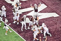 Texas A&M offensive lineman Joseph Cheek (79) celebrates touchdown by running back Brandon Williams (1) on the opening drive of an NCAA Football game, Saturday, September 27, 2014 in Arlington, Tex. Texas A&M defeated Arkansas 35-28 in overtime. (Mo Khursheed/TFV Media via AP Images)