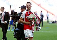 27th May 2018, Wembley Stadium, London, England;  EFL League 1 football, playoff final, Rotherham United versus Shrewsbury Town; Richard Wood of Rotherham United holds the EFL League 1 trophy