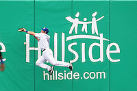 Buffalo Bisons outfielder Vinny Rottino #4 attempts to catch a fly ball during a game against the Pawtucket Red Sox at Coca-Cola Field on April 15, 2012 in Buffalo, New York.  Buffalo defeated Pawtucket 10-9 in ten innings.  (Mike Janes/Four Seam Images)
