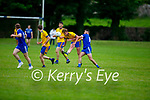Darragh O'Regan gets a late challenge from Donal Crean of Annascaul in Division 2b of the County Football League