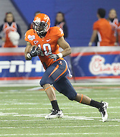 ATLANTA, GA - DECEMBER 31: Clifton Richardson #10 of the Virginia Cavaliers runs with the ball during the 2011 Chick Fil-A Bowl against the Auburn Tigers at the Georgia Dome on December 31, 2011 in Atlanta, Georgia. Auburn defeated Virginia 43-24. (Photo by Andrew Shurtleff/Getty Images) *** Local Caption *** Clifton Richardson