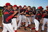 Batavia Muckdogs Walker Olis (3) is congratulated by teammates including Jose Diaz, RJ Peace (22), Travis Netback (16), and Chad Smith (34) after a walk off base hit during the second game of a doubleheader against the Auburn Doubledays on September 4, 2016 at Dwyer Stadium in Batavia, New York.  Batavia defeated Auburn 6-5. (Mike Janes/Four Seam Images)