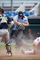 Umpire Dane Ponczak calls Daniel Johnson (30) out after being tagged by catcher Brett Sunde (24) during a game between the Vermont Lake Monsters and Auburn Doubledays on July 13, 2016 at Falcon Park in Auburn, New York.  Auburn defeated Vermont 8-4.  (Mike Janes/Four Seam Images)