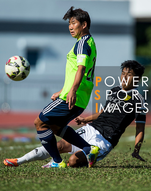 Haopeng Wu of Wofoo Tai Po (L) competes for the ball with Kwok Keung Sham of Sun Pegasus FC (R) during the HKFA Premier League between Wofoo Tai Po vs Sun Pegasus at the Tai Po Sports Ground on 22 November 2014 in Hong Kong, China. Photo by Aitor Alcalde / Power Sport Images