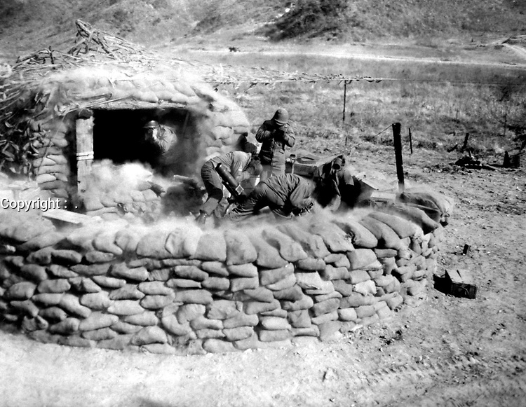 Men of the 4.2 mortar crew, 31st Heavy Mortar Co. fire at enemy position, west of Chorwon, Korea.  February 7, 1953.  Sgt. Guy A. Kassal. (Army)<br /> NARA FILE #:  111-SC-415620<br /> WAR & CONFLICT BOOK #:  1436