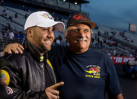 Nov 9, 2013; Pomona, CA, USA; NHRA top fuel dragster driver Shawn Langdon (left) celebrates with father Chad Langdon after clinching the 2013 championship following qualifying for the Auto Club Finals at Auto Club Raceway at Pomona. Mandatory Credit: Mark J. Rebilas-