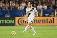 CARSON, CA - SEPTEMBER 15: Dave Romney #4 of the Los Angeles Galaxy crosses a ball during a game between Sporting Kansas City and Los Angeles Galaxy at Dignity Health Sports Complex on September 15, 2019 in Carson, California.