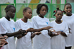 Haitian girls learn proper hand washing techniques, including the use of anti-bacterial foam, during activities at a youth center run by the YWCA in Petionville. The program educates and empowers girls, many of whom don't go to school, who come from families affected by the January 2010 earthquake. Many live in tents that fill a nearby park. The focus on hygiene has taken on more importance since the appearance of cholera in Haiti in late 2010.