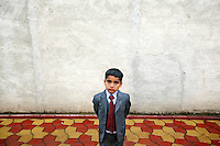 A boy poses at the baptism of Florin Petrache. Buzescu is known for it's ultra-wealthy Roma and their bizarre mansions that line the main street. The Roma of Buzescu are part of the Kalderash clan and are known for being coppersmiths and dealing with metal scraps. After the fall of the communist regime in the late 80's, they stripped old factories of their metals and some made a small fortune re-selling them. They are also known for making cazane, copper stills that produce alcohol such as palinka, a plum brandy.