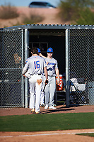 Paul Moore (8) of Stone Bridge High School in Ashburn, Virginia greets Connor Walsh (16) of Niceville High School in Niceville, Florida during the Baseball Factory All-America Pre-Season Tournament, powered by Under Armour, on January 13, 2018 at Sloan Park Complex in Mesa, Arizona.  (Zachary Lucy/Four Seam Images)