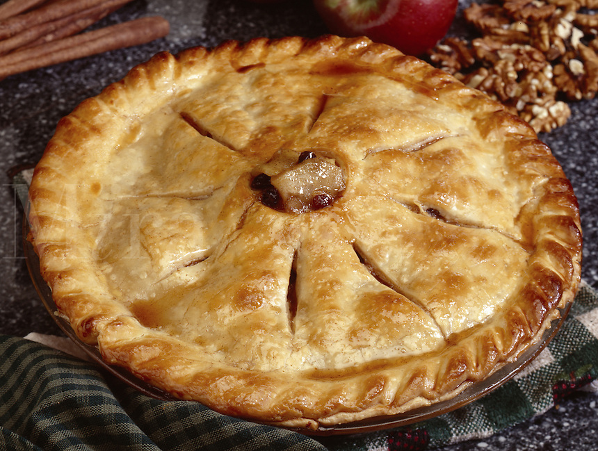 Apple pie, showing red apples and cinnamon sticks