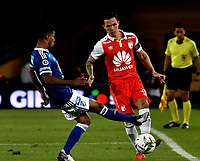 BOGOTÁ - COLOMBIA, 15-01-2019: Luis Seijas (Der.) jugador de Independiente Santa Fe disputa el balón con César Carrillo (Izq.) jugador de Millonarios, durante partido entre Independiente Santa Fe y Millonarios, por el Torneo Fox Sports 2019, jugado en el estadio Nemesio Camacho El Campin de la ciudad de Bogotá. / Luis Seijas (R) player of Independiente Santa Fe vies for the ball with con Cesar Carrillo (L) player of Millonarios during a match between Independiente Santa Fe and Millonarios, for the Fox Sports Tournament 2019, played at the Nemesio Camacho El Campin stadium in the city of Bogota. Photo: VizzorImage / Luis Ramírez / Staff.