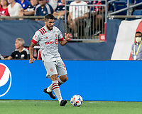 FOXBOROUGH, MA - JULY 7: Alejandron Pozuelo #10 of Toronto FC passes the ball during a game between Toronto FC and New England Revolution at Gillette Stadium on July 7, 2021 in Foxborough, Massachusetts.