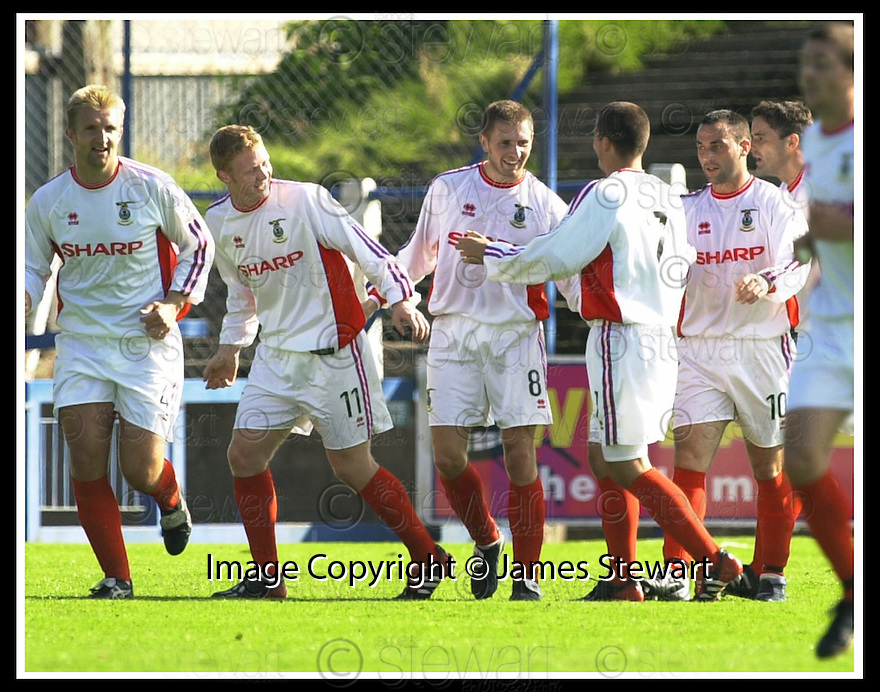 14/9/02       Copyright Pic : James Stewart                     .File Name : stewart-qots v inverness 10.DENNIS WYNESS (8) IS CONGRATULATED AFTER HE SCORED CALEEY'S SECOND GOAL....James Stewart Photo Agency, 19 Carronlea Drive, Falkirk. FK2 8DN      Vat Reg No. 607 6932 25.Office : +44 (0)1324 570906     .Mobile : + 44 (0)7721 416997.Fax     :  +44 (0)1324 570906.E-mail : jim@jspa.co.uk.If you require further information then contact Jim Stewart on any of the numbers above.........