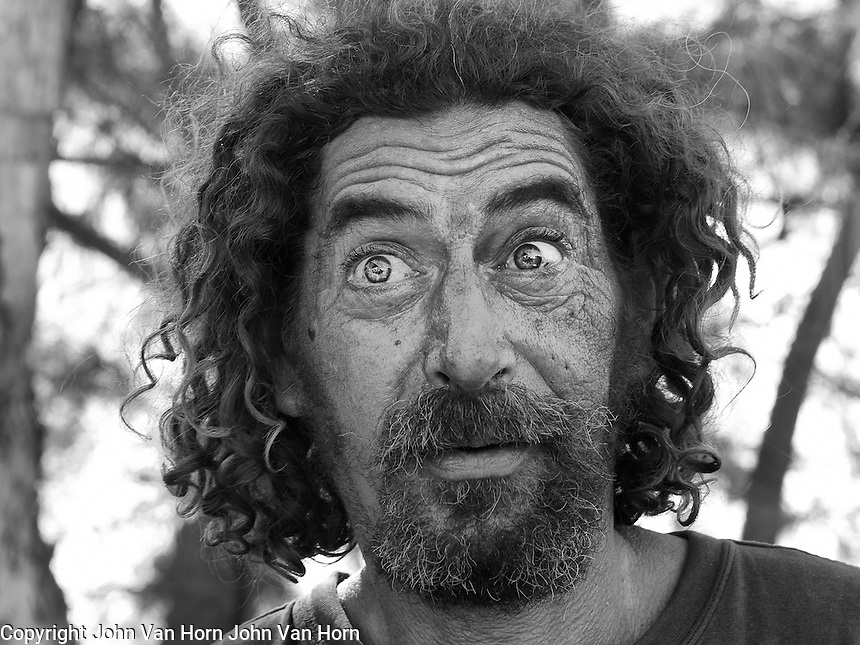 OLYMPUS DIGITAL CAMERA John, Florida Keys Lobsterman. John working on the boats pulling lobster traps and crab traps. It is hard work as you can see in his weathered features.