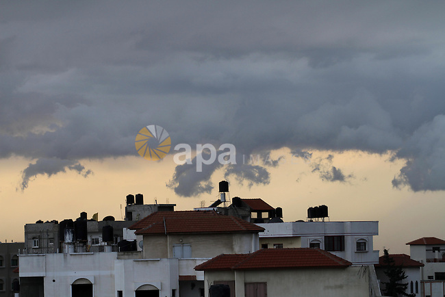 A general picture shows clouds over Gaza City, on March 11, 2014. Photo by Mohammed Asad