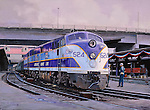 "Atlantic Coast Line railroad passenger train ""Silver Comet"" at the Atlanta Terminal Station tation ready for travel on a national holiday, the Fourth of July. Oil on canvas, 18 x 24.5."