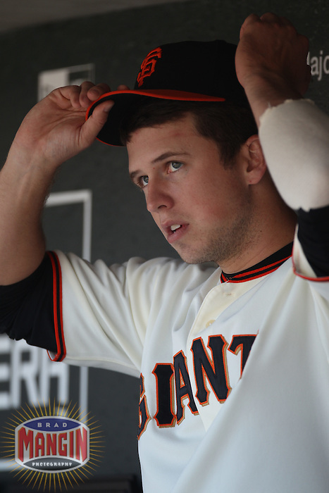 SAN FRANCISCO - AUGUST 29:  Buster Posey #28 of the San Francisco Giants sits in the dugout and watches the game with a wrap on his injured left forearm during the game against the Arizona Diamondbacks at AT&T Park on August 29, 2010 in San Francisco, California. Photo by Brad Mangin