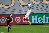 LOS ANGELES, CA - OCTOBER 25: Julian Araujo #22 of the Los Angeles Galaxy heads a ball during a game between Los Angeles Galaxy and Los Angeles FC at Banc of California Stadium on October 25, 2020 in Los Angeles, California.
