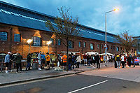 Pictured: A crowd of people gather outside the Rasoi restaurant in SA1, in Swansea. Friday 16 April 2021<br /> Re: People enjoy an evening out after Covid-19 lockdown rules were relaxed, in Swansea Bay, Wales, UK.
