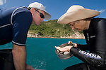 Chris Glasby and Charlotte Watson sieve out sand from the trawler sand collector  to look for polychaete worms,  annelids that are also called bristle worms.