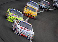 Feb 22, 2009; Fontana, CA, USA; NASCAR Sprint Cup Series driver Bobby Labonte leads Mark Martin and Clint Bowyer during the Auto Club 500 at Auto Club Speedway. Mandatory Credit: Mark J. Rebilas-