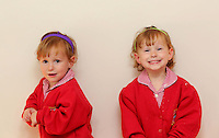 """Pictured L-R: Paige with sister Maddison<br /> Re: A set of identical triplets have been colour-coded to help teachers tell them apart on their first day in nursery school.<br /> Three-year-olds Ffion, Maddison and Paige Gilbert, are so alike even their parents struggle to know which is which.<br /> Karen and Ian Gilbert used different coloured nail-varnish on their fingers and toes to identify them when they were babies.<br /> Now the couple are using the same colours for their hair bands and bobbles at the nursery where they have just enrolled.<br /> And the colours even correspond with the names of the identical trio. <br /> Ffion has fuschia, Maddison has mint and Paige has purple.<br /> Karen, 35, of Pontypool, South Wales, said: """"We have colour-coded them since they were tiny babies - it helped us keep track of which ones had been fed.<br /> """"But nail varnish isn't allowed in school so we had come up with come other way."""